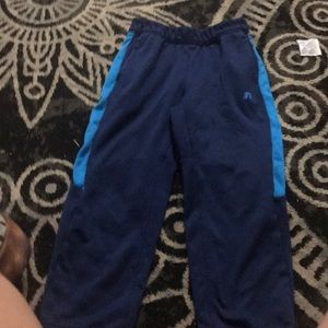 A blue and light blue sweat pants a large in kids.